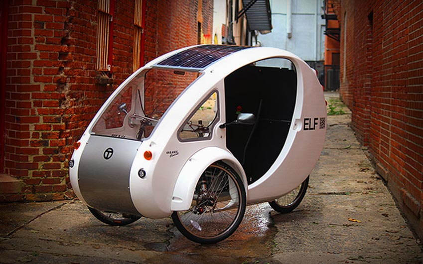 Organic Transit Elf promotional video thumbnail depicting white color Elf vehicle in brick alley in Sacramneto, California
