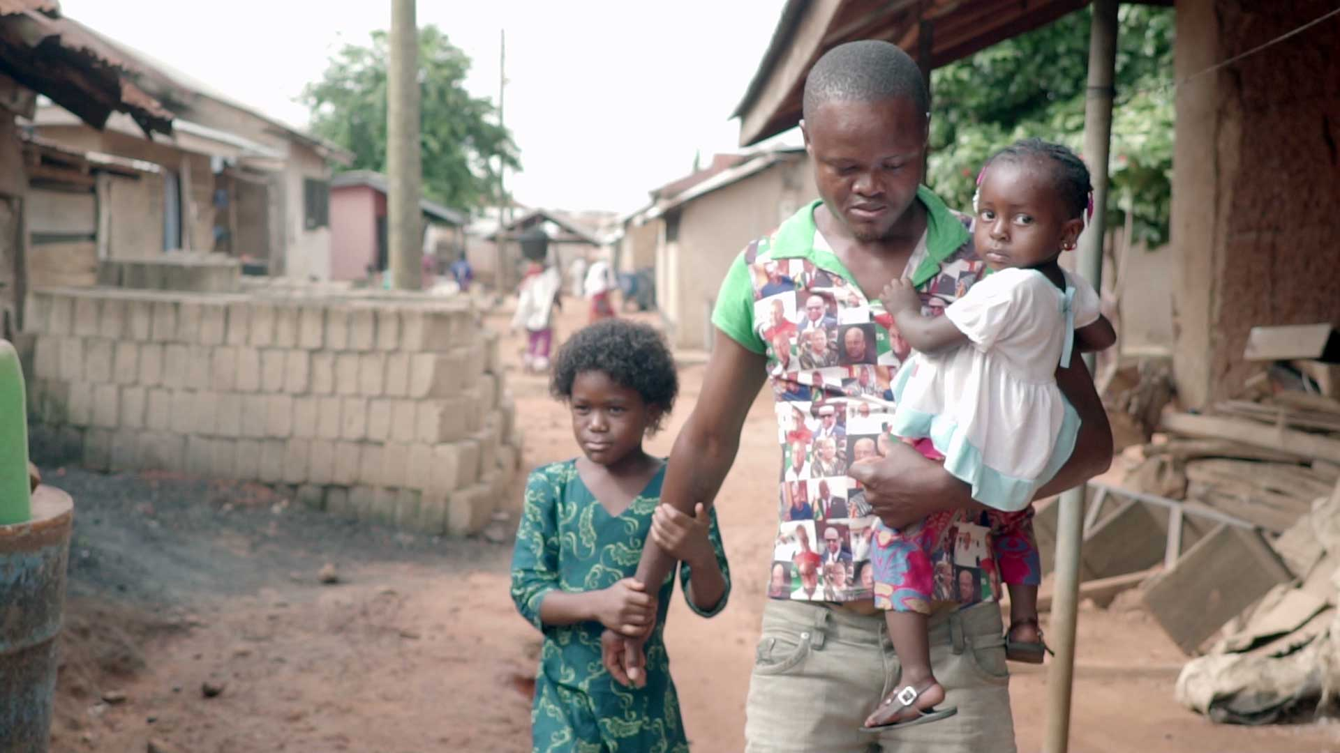 Ghana Documentary Image of Village Family Walking